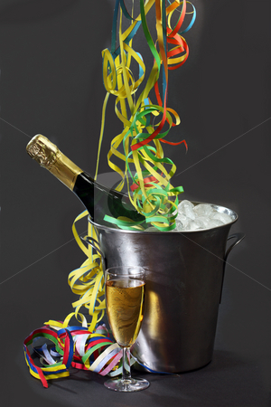 Champagner stock photo, Champagne bottle in a cooler with ice on black background by Birgit Reitz-Hofmann