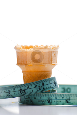 Dieting stock photo, Concept image of a diet featuring a measuring tape around an empty ice cream cone, shot on white by Richard Nelson
