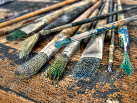 Painter's brushes stock photo, Closeup of used brushes and colors in one art studio. by Sinisa Botas