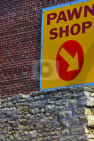 Pawn Shop Sign stock photo, Low angle view of a red and yellow sign for a