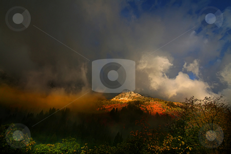 Autumn Storm stock photo, High Mountain Flat in the fall showing all the fall colors with mountains in the background by Mark Smith