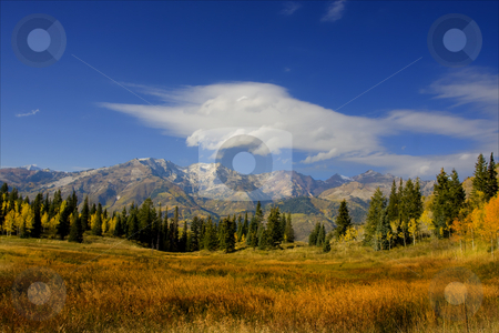 Fall Splender stock photo, High Mountain Flat in the fall showing all the fall colors with mountains in the background by Mark Smith