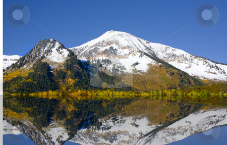 Fall Colors stock photo, High Mountain Flat in the fall showing all the fall colors with mountains in the background by Mark Smith