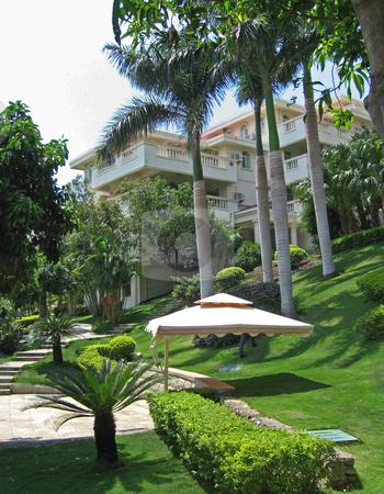 Beautiful front lawn of tropical resort stock photo,  by Shi Liu
