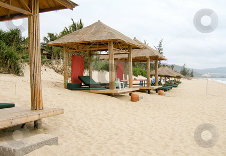 Cabanas on a sandy beach stock photo, Bamboo cabanas on beach at luxurious resort by Shi Liu