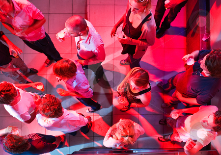 Party viewed from above stock photo, A party on the dancefloor of a nightclub as viewed from above. by Corepics VOF