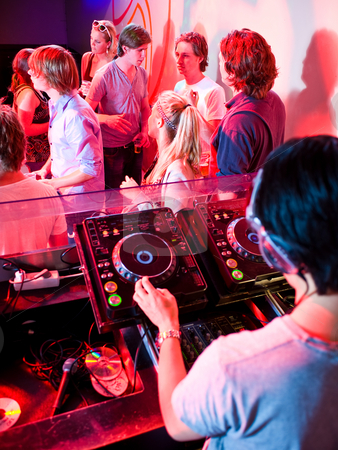 DJ booth stock photo, Party in a nightclub viewed from the DJ booth by Corepics VOF