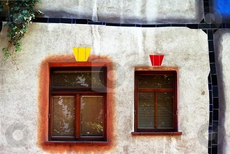 Two windows in organic facade stock photo, Detail of two windows in organic facade by Juraj Kovacik
