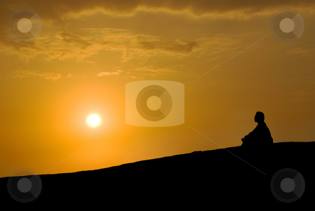 Meditation under sunset stock photo, Meditation under sunset, Buddhist activity by Lawren
