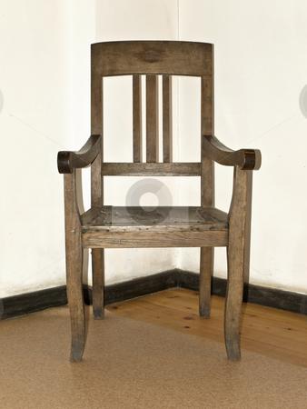 Old stool stock photo, Old wooden stool in the corner of room by Sergej Razvodovskij