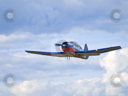 Airplane  stock photo, Single small airplane against the cloudy sky by Sergej Razvodovskij
