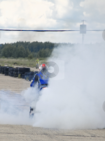 Start  stock photo, Motor-cyclist on the start line into the smoke cloud by Sergej Razvodovskij