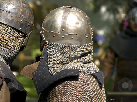 Knights stock photo, Two talking armored knights at the park by Sergej Razvodovskij