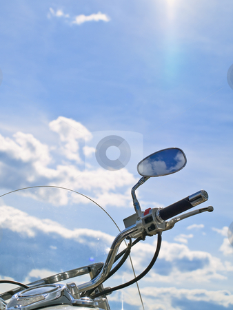 Sky and bike stock photo, Motorcycle handle with mirror against cloudy sky by Sergej Razvodovskij