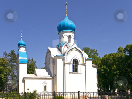 Oriental white Church stock photo, Oriental white Church with blue cupola against the blue sky by Sergej Razvodovskij