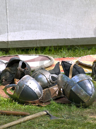 Armor stock photo, Some knights helmets and weapons over the shields by Sergej Razvodovskij