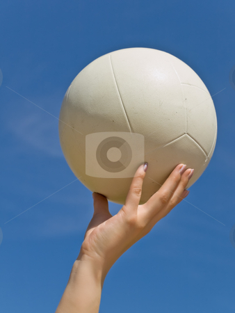 Volleyball stock photo, White ball in the woman hand against the blue sky by Sergej Razvodovskij