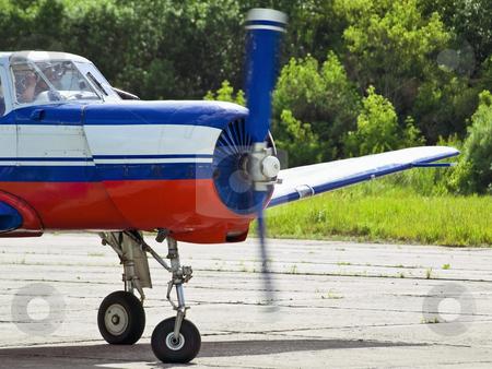Airplane stock photo, Airplane ready to fly on the air strip by Sergej Razvodovskij