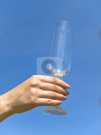 Wineglass stock photo, Empty wineglass in woman hand against the blue sky by Sergej Razvodovskij