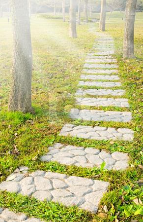 Stone walkway stock photo, Stone walkway winding in park by Lawren