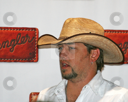 Jason Aldean - CMA Music Festival 2009 stock photo, Jason Aldean at the CMA Festival 2009 in Nashville, Tennessee signing autographs by Dennis Crumrin