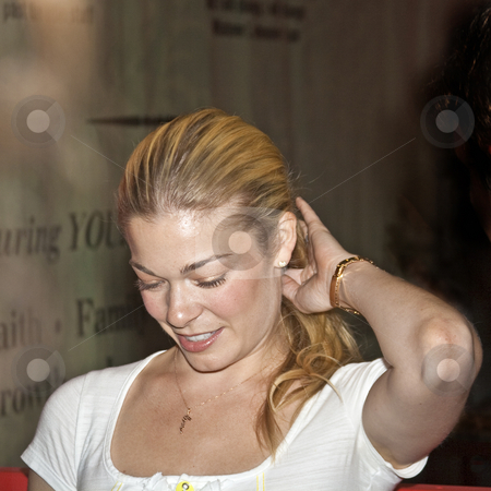 LeeAnn Rimes - CMA Festival 2009 stock photo, LeeAnn Rimes at the CMA Festival 2009 in Nashville, Tennessee signing autographs by Dennis Crumrin