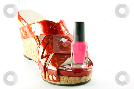 pink nail polishes. Single red shoe and pink nail