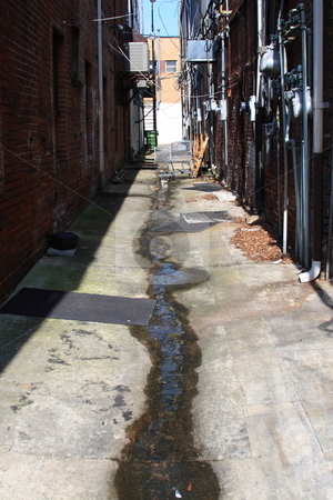 Alley  stock photo, Grungy alley way behind various bussiness with utillitie systems by Jack Schiffer