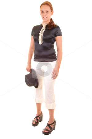 Dressed up woman. stock photo, An all dressed up woman in black blouse and white trousers, with a hat in her hand and a necktie made from white pearls, for white background. by Horst Petzold