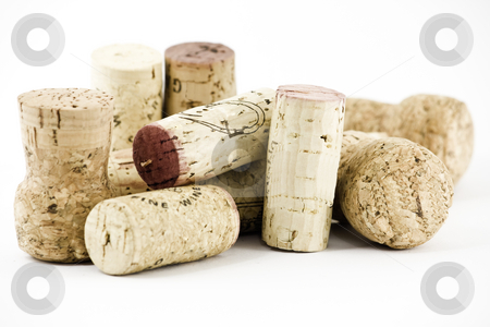 Pile of corks stock photo, A pile of wine and champagne corks, isolated on white by Arek Rainczuk