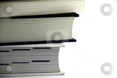 Stack of books - close up stock photo, Close up on a stack of three books, isolated on white by Arek Rainczuk