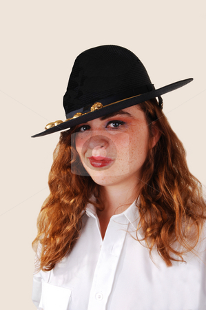 Girl security guard. stock photo, Pretty red haired woman security guard with the big black hat an white blouse, smiling and looking in the camera, on white background. by Horst Petzold