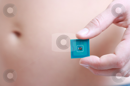 A studio shot of a woman holdingRadio-frequency identification (RFID) tag card stock photo, A studio shot of a woman holding in her hand Radio-frequency identification (RFID) tag card. Room for text or your own message by Andrey Yanevich