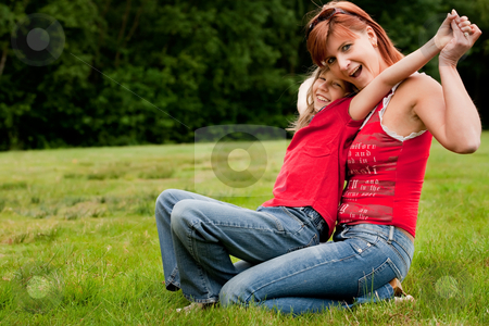 Happy little family stock photo, Mother and Daughter are happy in the park by Frenk and Danielle Kaufmann