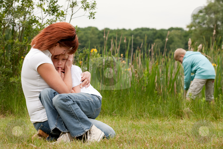 Mother and her 2 kids stock photo, Mother and her kids are happy in the park by Frenk and Danielle Kaufmann