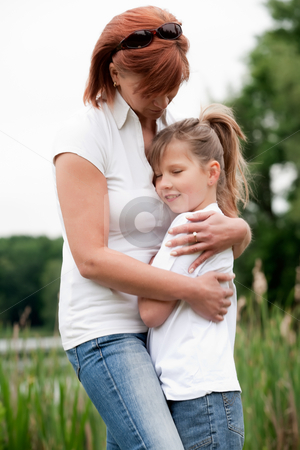 Swee child care stock photo, Mother and Daughter are happy in the park by Frenk and Danielle Kaufmann