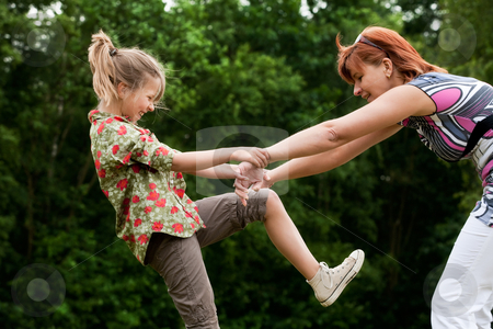 Happy girl is playing stock photo, Mother and Daughter are happy in the park by Frenk and Danielle Kaufmann