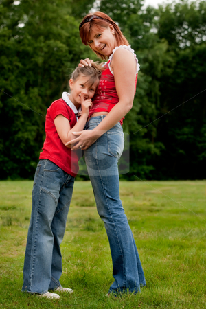 Happy mother and daugther in red stock photo, Mother and Daughter are happy in the park by Frenk and Danielle Kaufmann