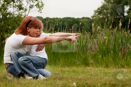 Pointing together stock photo, Mother and Daughter are happy in the park by Frenk and Danielle Kaufmann