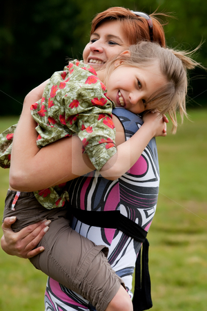 Hugging with my mother stock photo, Mother and Daughter are happy in the park by Frenk and Danielle Kaufmann