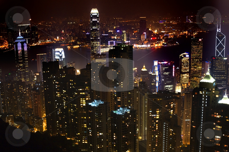 Hong Kong Skyline At Night from Victoria Peak stock photo, Hong Kong Skyline and Harbor at Night from Victoria Peak  Trademarks removed by William Perry