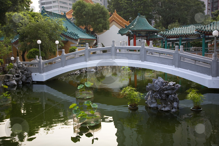 Chinese Good Fortune Water Garden Bridge Reflection Wong Tai Sin stock photo, Chinese Good Fortune Water Garden Bridge Reflection Wong Tai Sin Taoist Temple Kowloon Hong Kong by William Perry