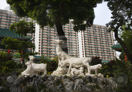Goat Statue Wong Tai Sin Buddhist Taoist Temple Kowloon Hong Kon stock photo, Goat Statue Modern Apartment Buildings Wong Tai Sin Buddhist Taoist Confucian Temple Kowloon Hong Kong  