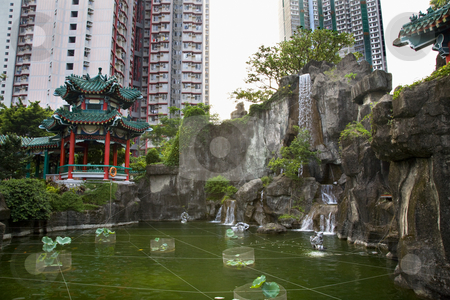 Water Garden High Rise Buildings Wong Tai Sin Taoist Temple Kowl stock photo, Chinese Good Fortune Water Garden High Rise Apartment Buildings Wong Tai Sin Taoist Temple Kowloon Hong Kong by William Perry