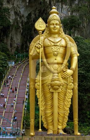Lord Murugan statue Batu Caves stock photo, Statue of Lord Murugan with steps leading to Batu Caves by Robert Ford