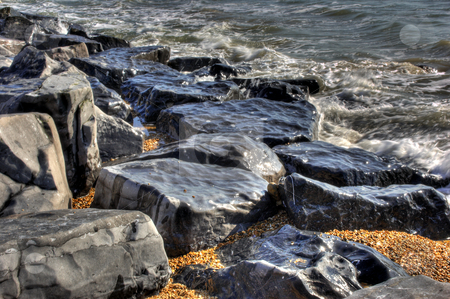 Rugged Shore Rocks stock photo, High Definition effect of rugged rocks on shoreline by Robert Ford