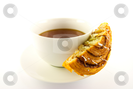Half Cinnamon Bun and Tea stock photo, Half a cinnamon bun and cup of tea with clipping path on a white background by Keith Wilson