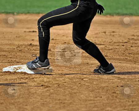 Playing 2nd Base stock photo, Waist down shot of a woman plyaing second base. by W. Paul Thomas