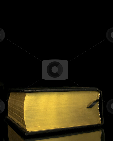 Thick book with copy space stock photo, Thick book on a black background with copy space by John Teeter