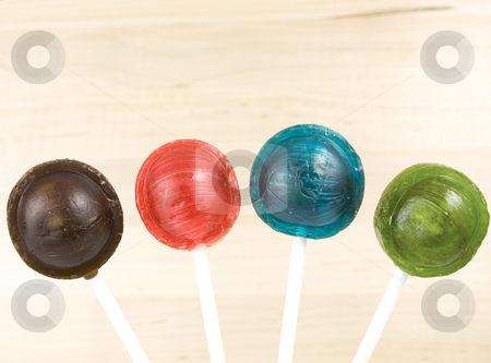Lollipop Candy stock photo, Four different colored lollipops by John Teeter